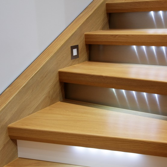Staircase with wooden steps and illumination