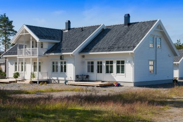 white wooden house in norway